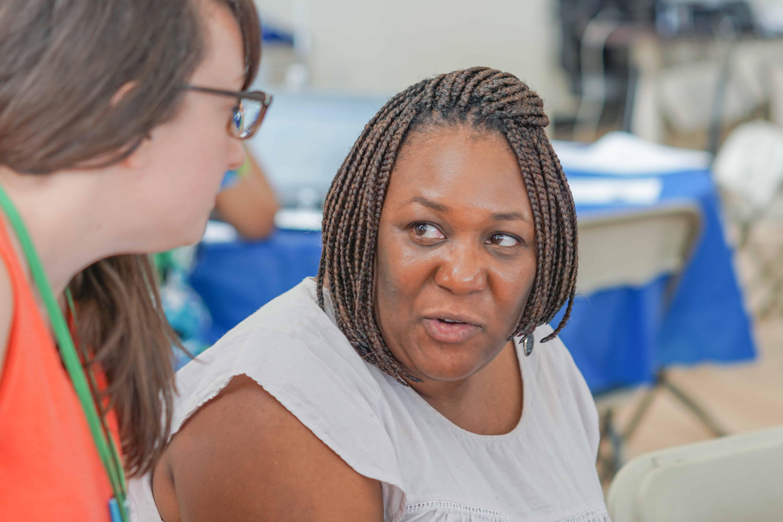 Coach Amanda Silva talks to a LEAP leader