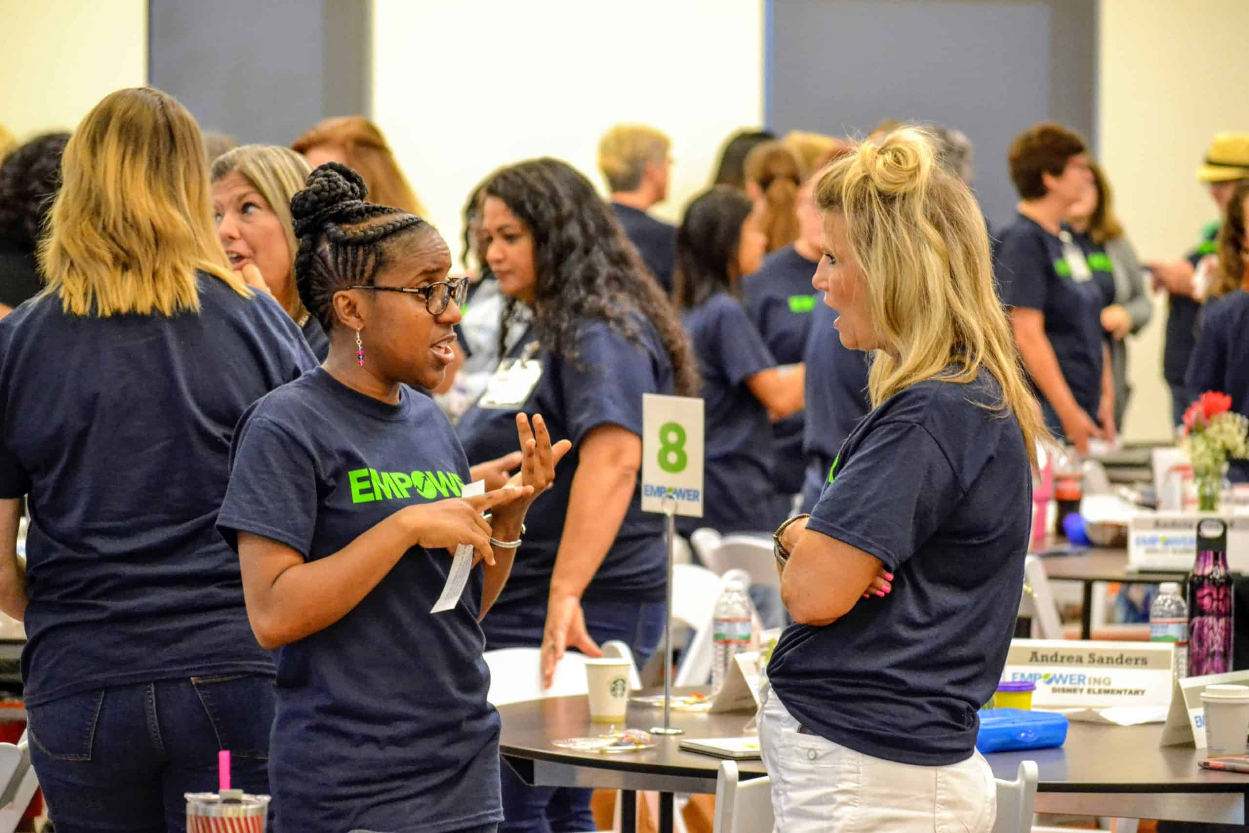 Two Tulsa Empower educators chat during a workshop