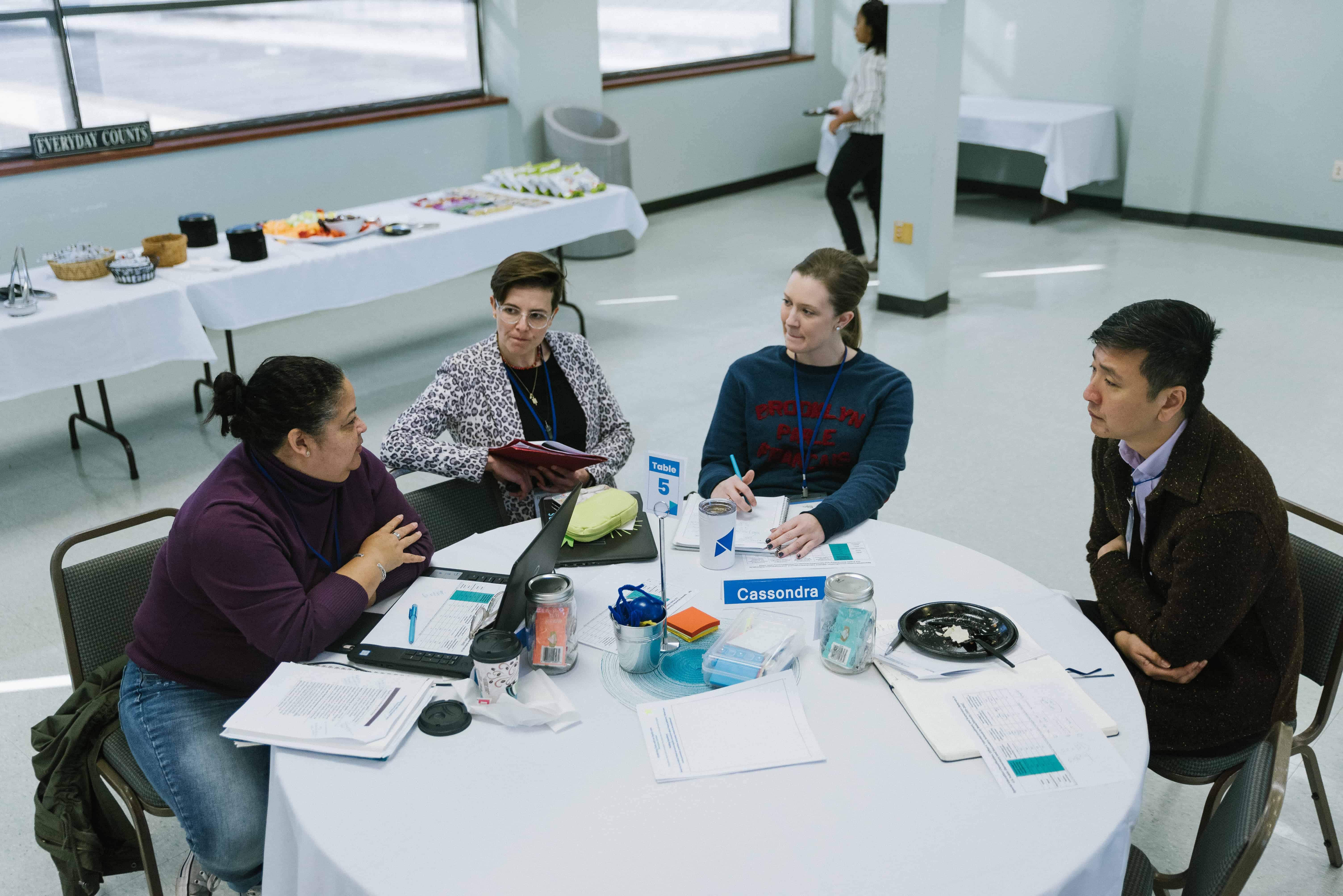 Chong-Hao Fu, Rachel Scarpato and Louisiana teachers talk around a table