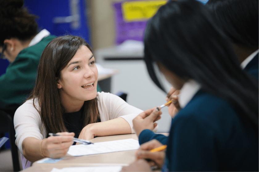 a teacher talks to a student