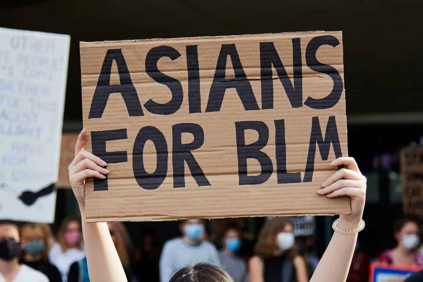 A protest sign that says Asians for BLM
