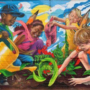 mural of kids planting a garden together