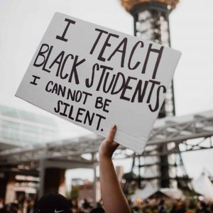 """Sign reads """"I Teach Black Students I Cannot Be Silent"""""""