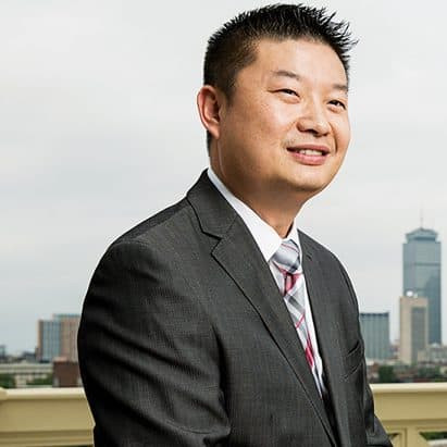 tommy chang in front of a skyline