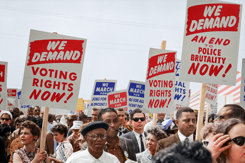 historical photo of diverse people marching for voting rights