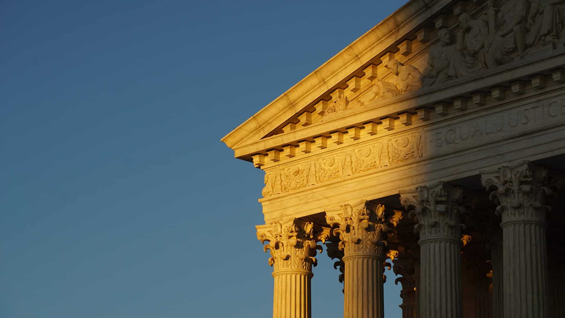 US Supreme Court building façade during sunset