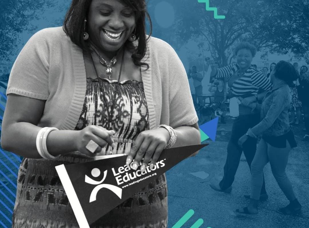 a teacher leader talks while holding a pennant